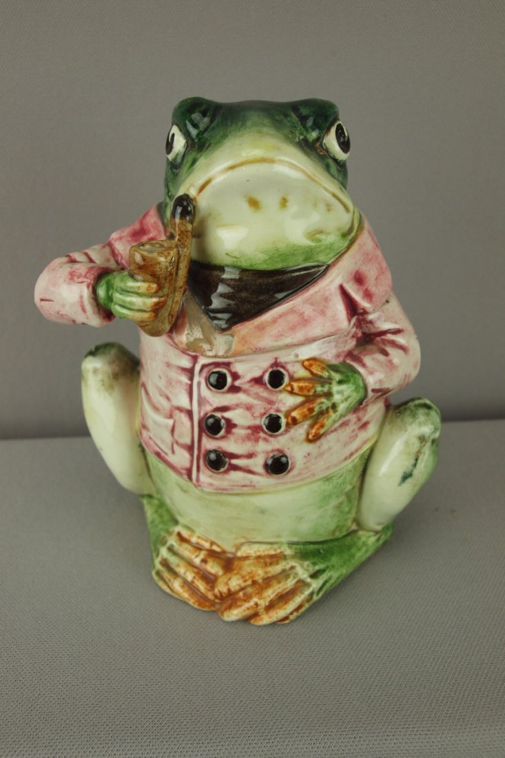 407:  Continental majolica frog tobacco jar with red sm