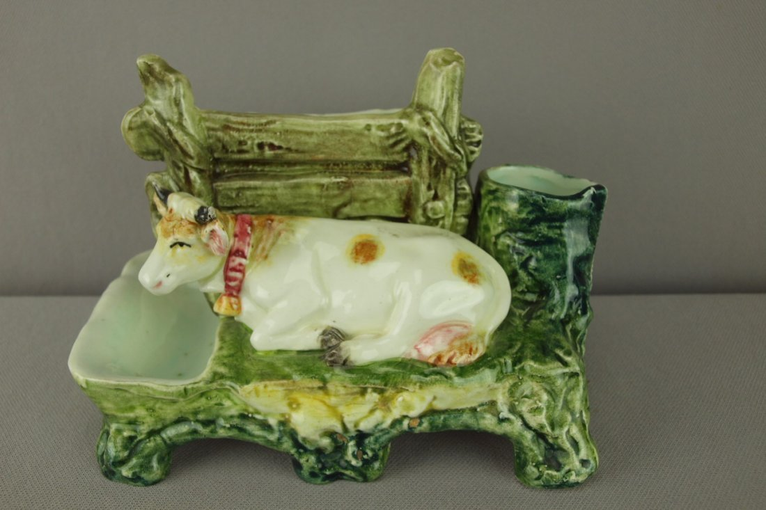 413:  Continental majolica figural match striker with c