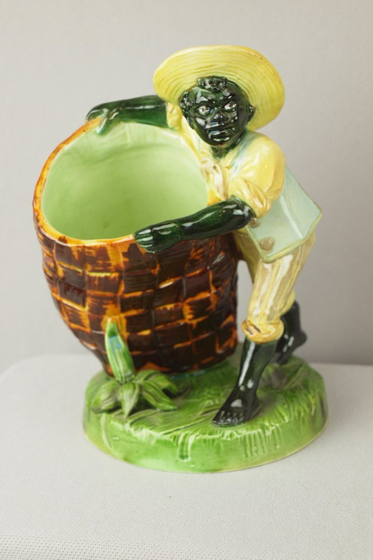 422:  Majolica figural vase with blackamoor with wicker
