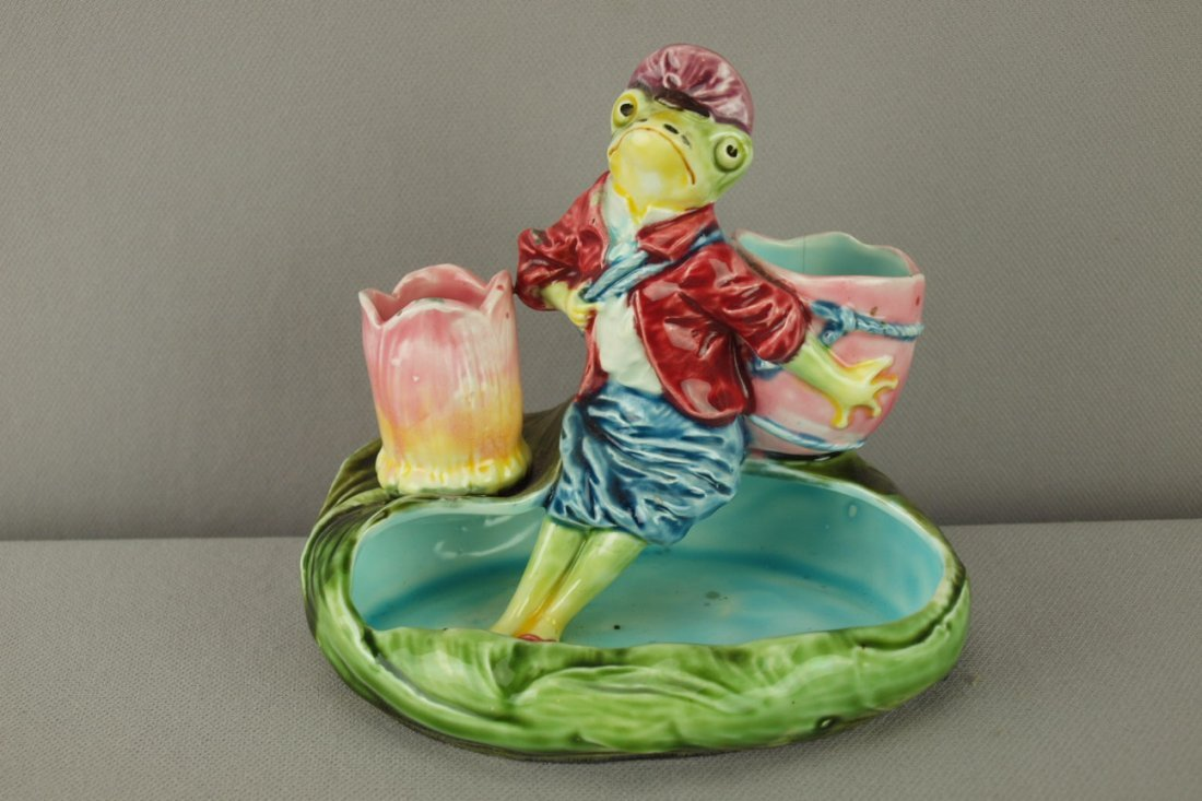 423:  Continental majolica match striker with lady frog