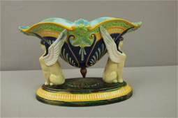 569  GEORGE JONES majolica sphinx table center with co