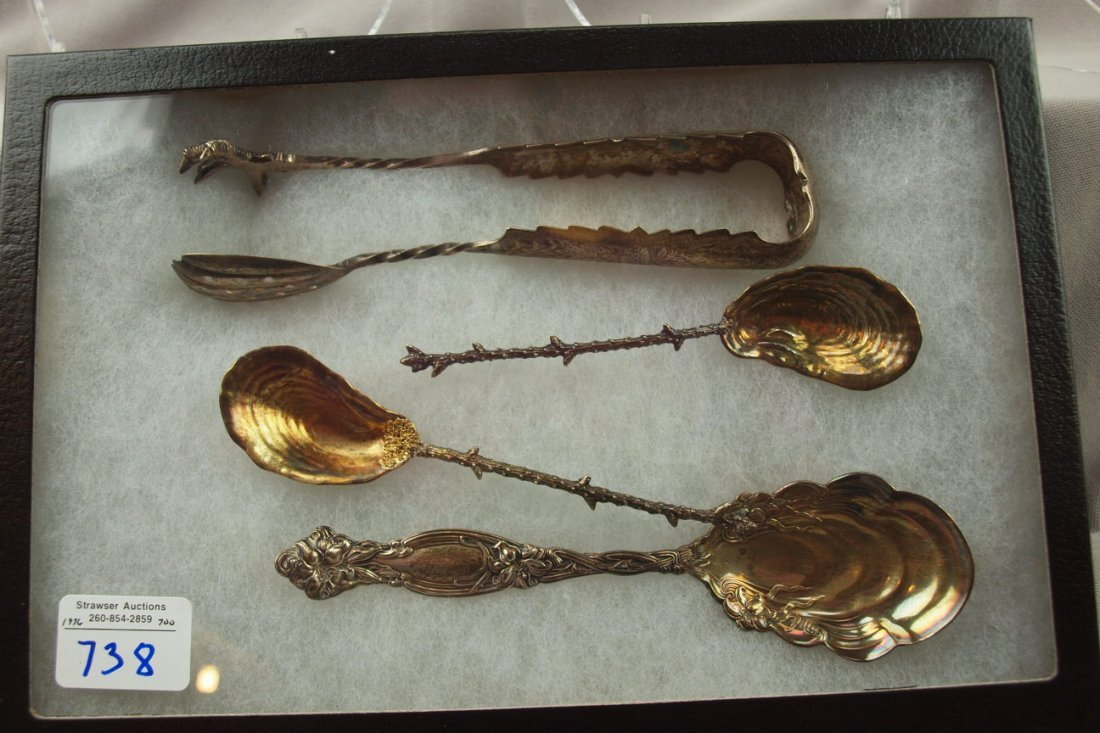 738:  Lot of sterling silver oyster spoons, 2 with gold