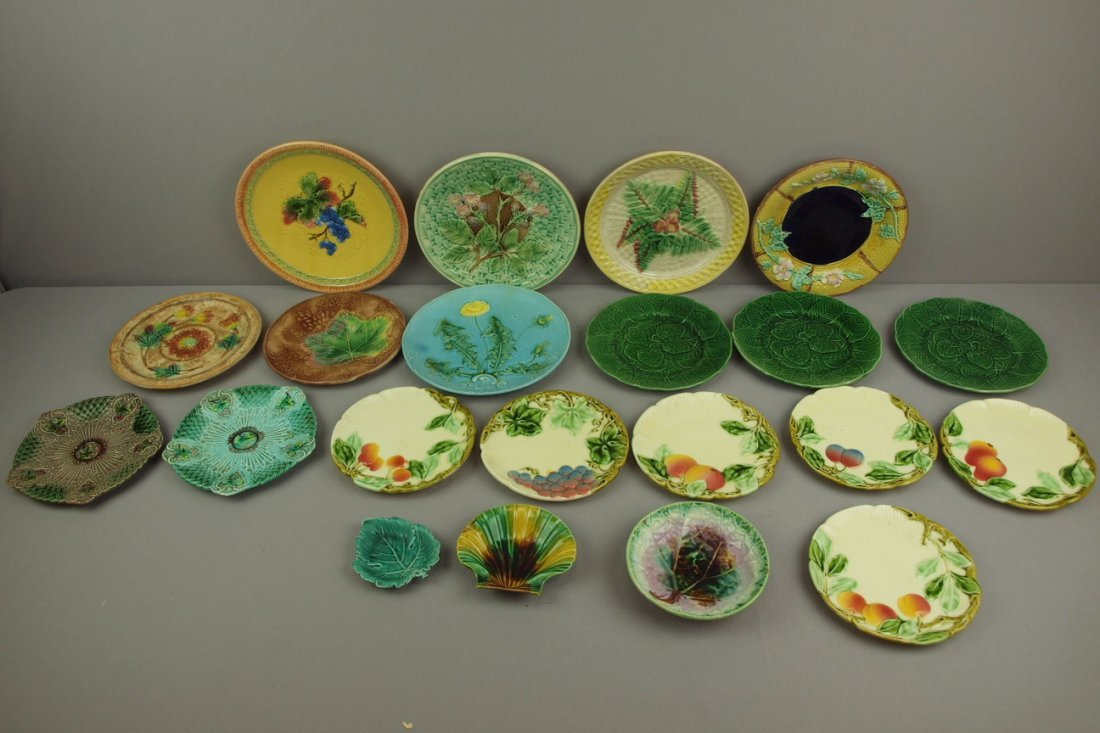 Majolica lot of 21 plates,   various condition