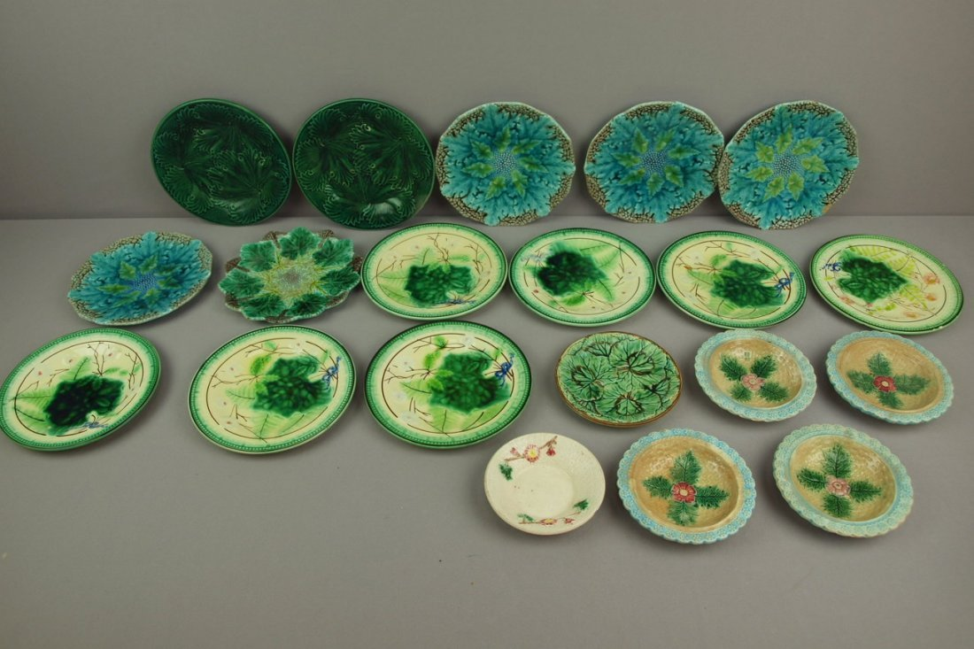 Majolica lot of 20 plates and   sauce dishes, various