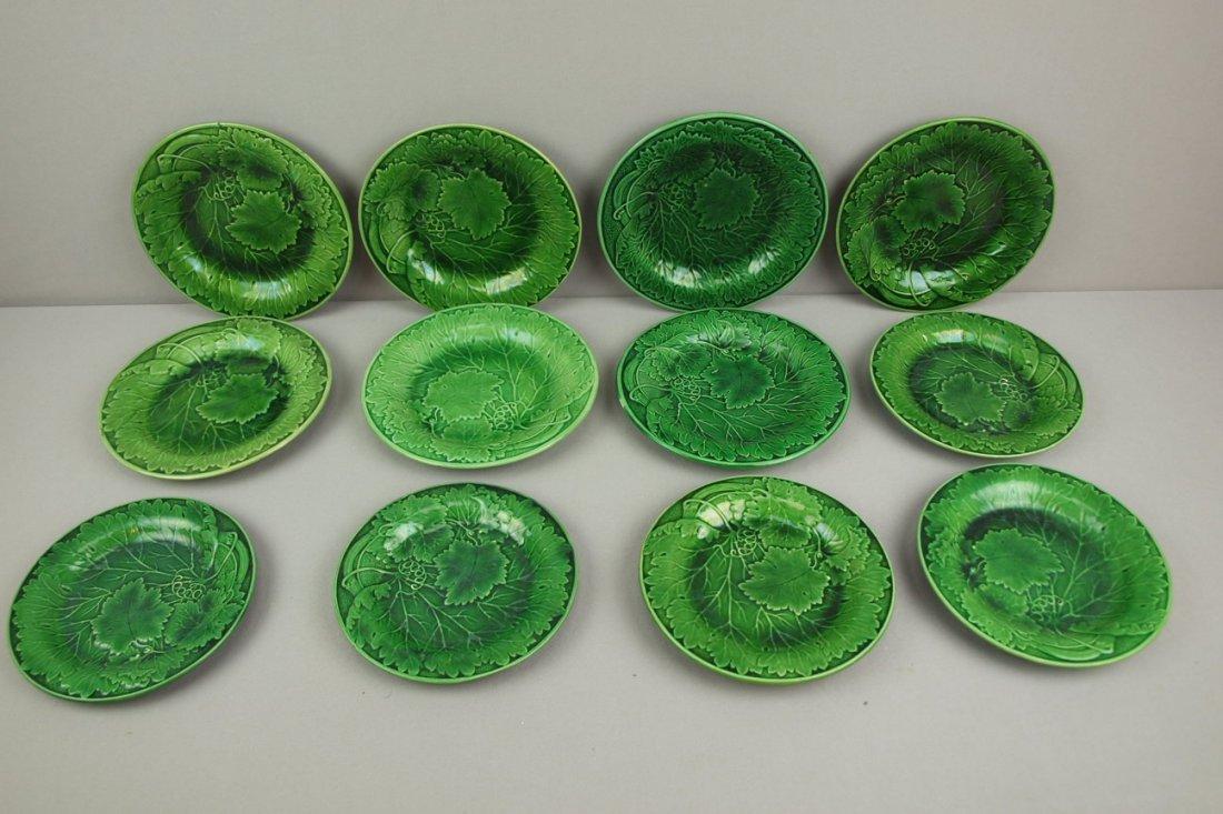 Majolica lot of 12 dark green   plates, various condit