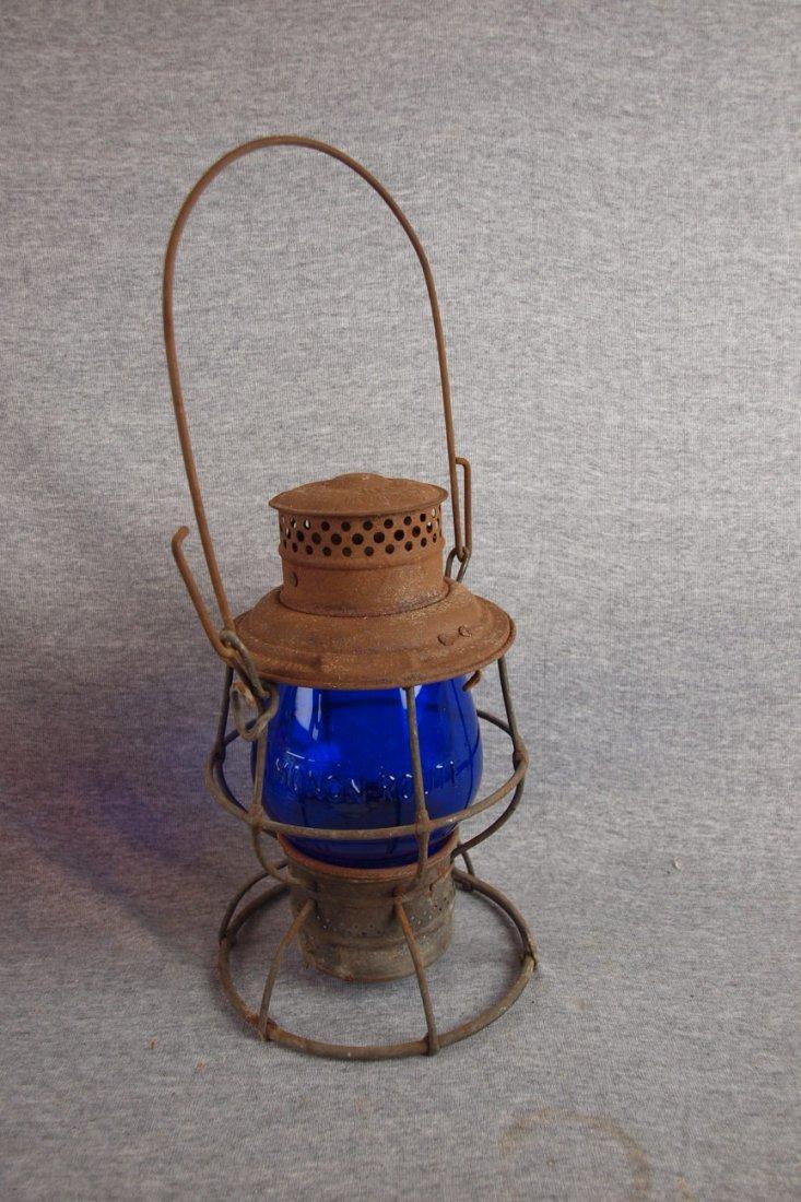 Adlake railroad lantern with   cobalt blue globe emboss