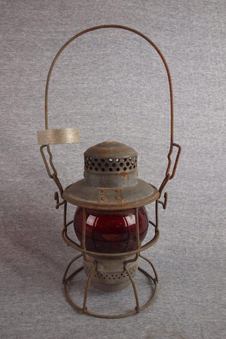Adlake railroad lantern with   red globe, frame embosse