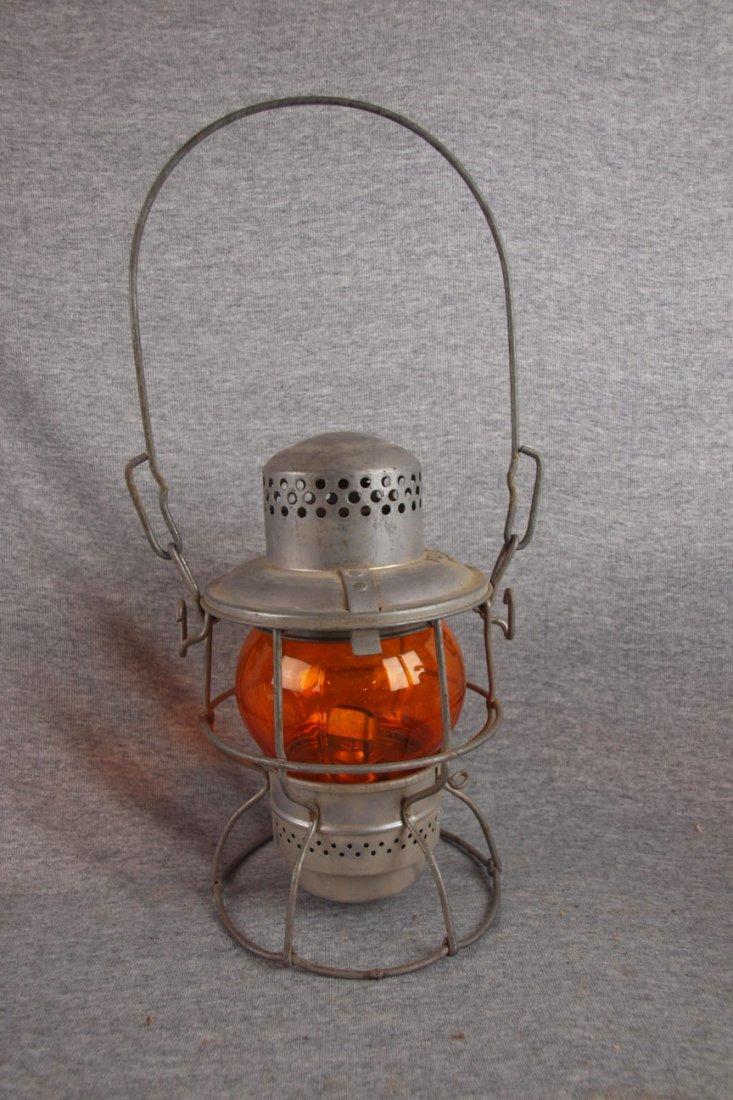 Adlake railroad lantern with   amber globe