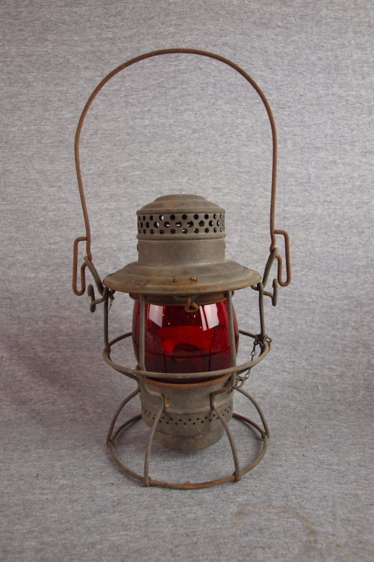 Railroad lantern with red   globe