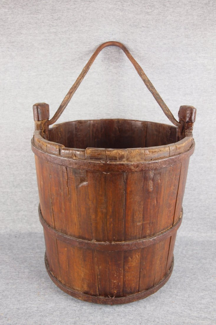 Early wooden stave bucket   with hand forged iron bail