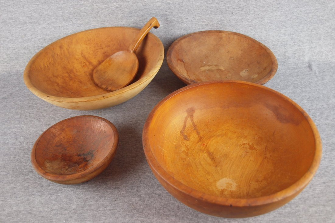 Lot of 4 wooden bowls and one   wooden butter paddle