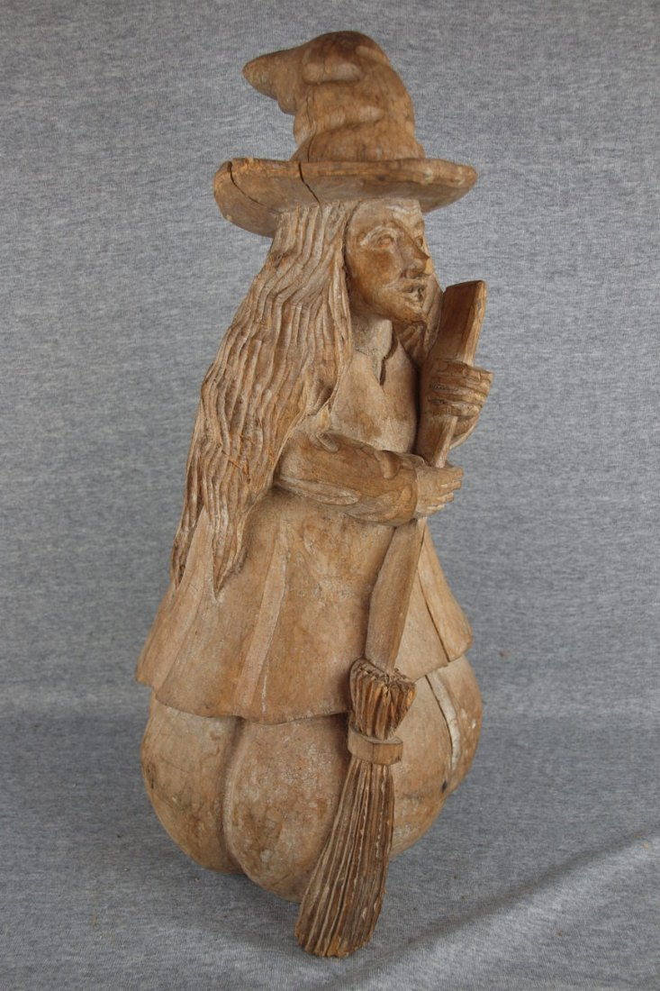 Wooden paper mache' mold in   the form of a witch with