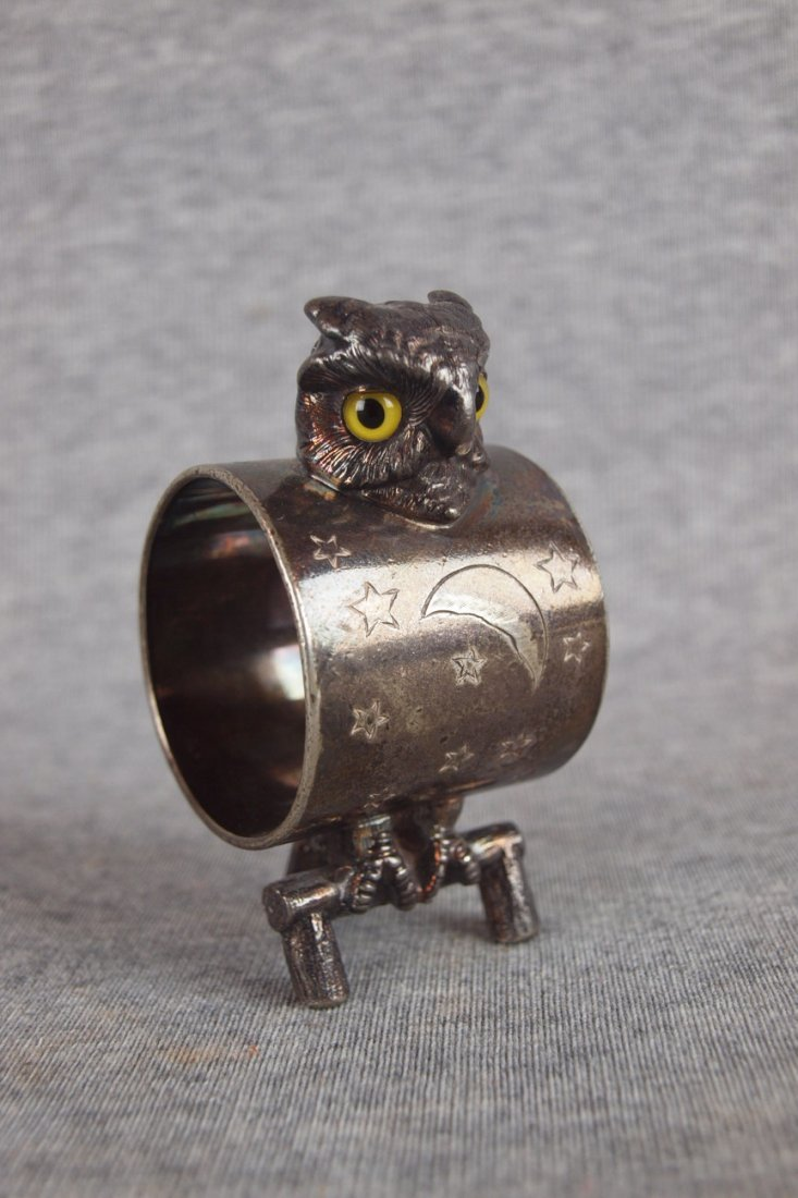 Silver figural napkin ring of   an owl with glass eyes,