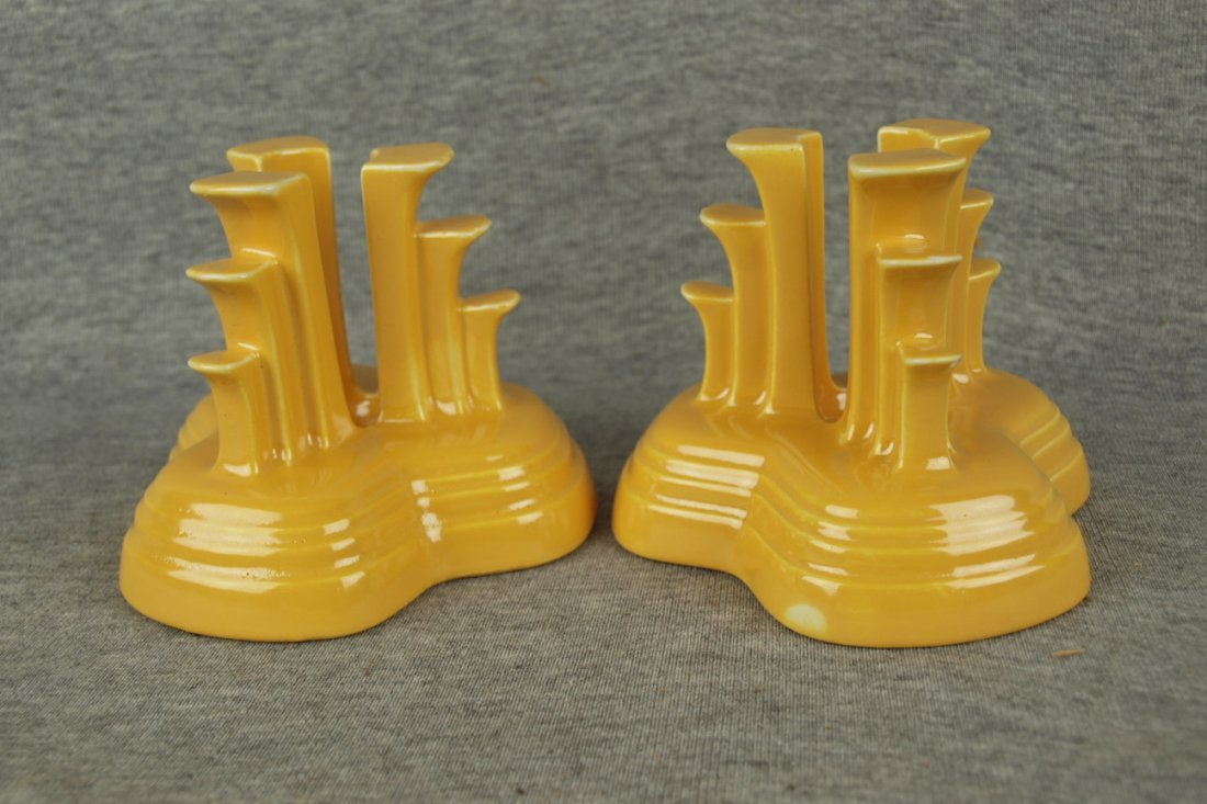 Fiesta pair of tripod candles, yellow, nicks to one