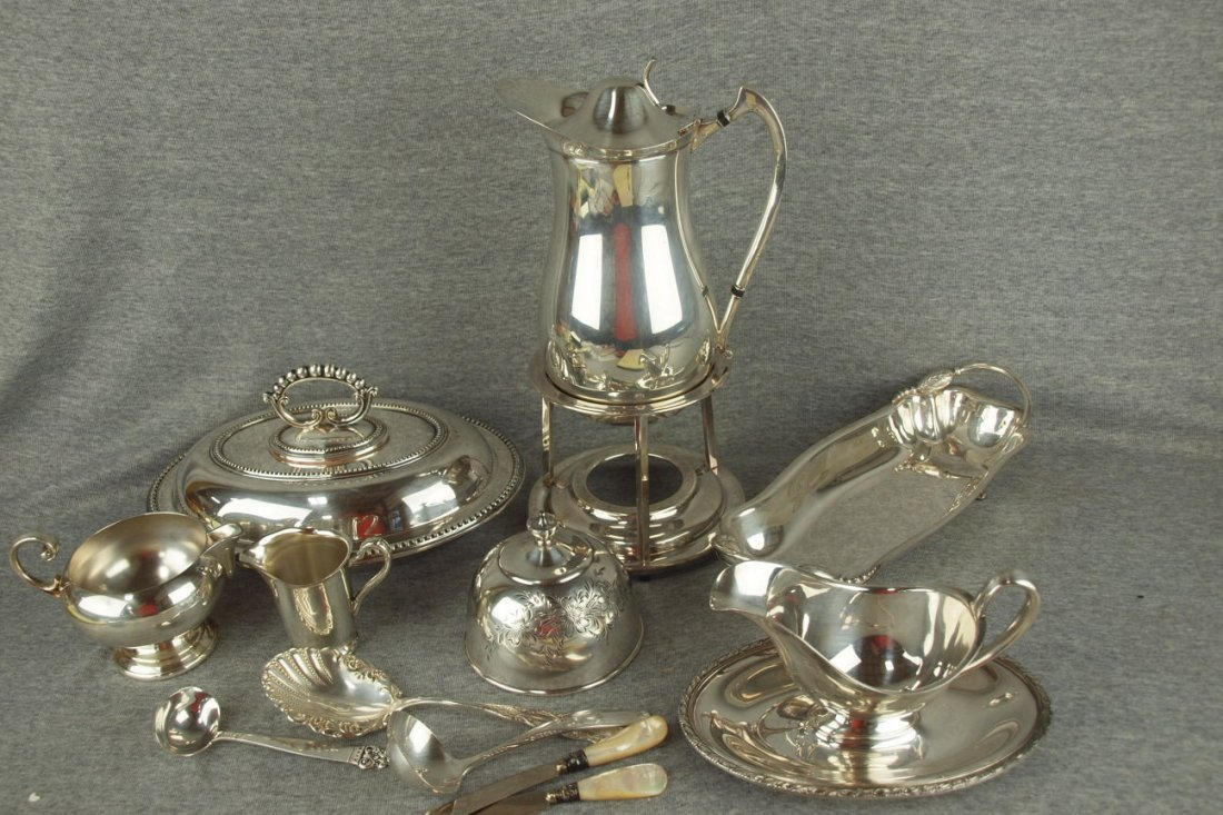 Lot of 7 silver plate serving pieces and 5 pieces of