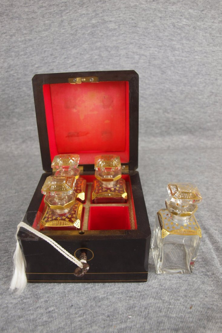 French set of 4 gold enamel perfume bottles in original