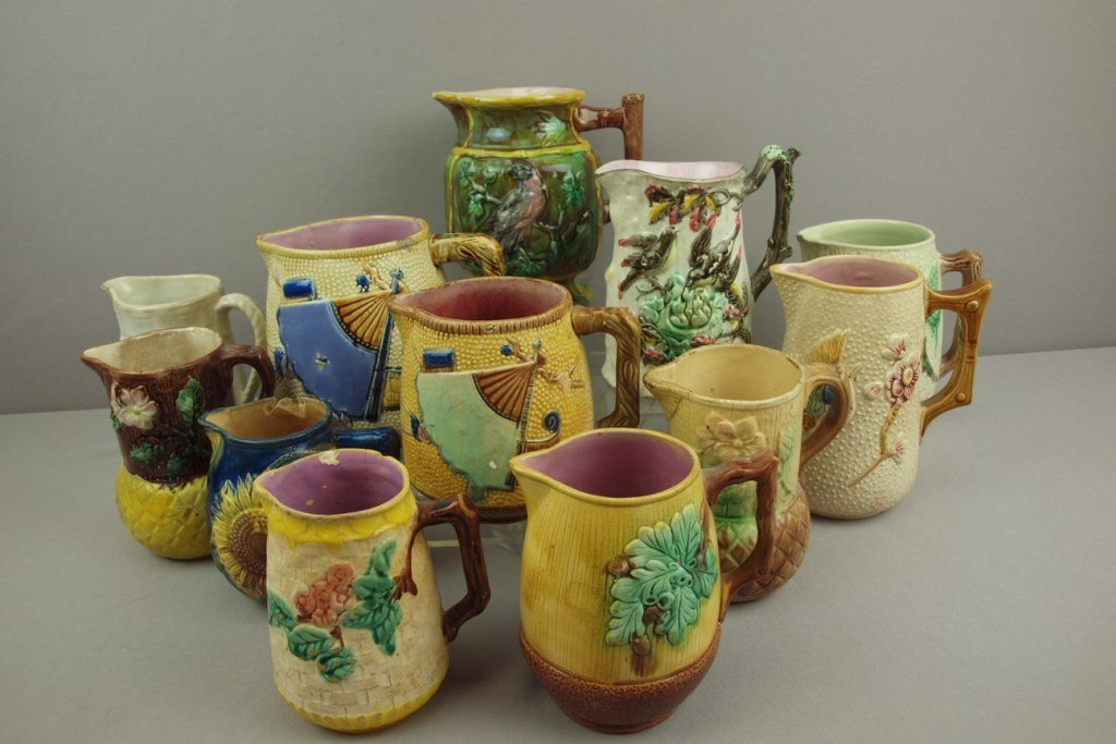 Majolica lot of 12 pitchers, various condition