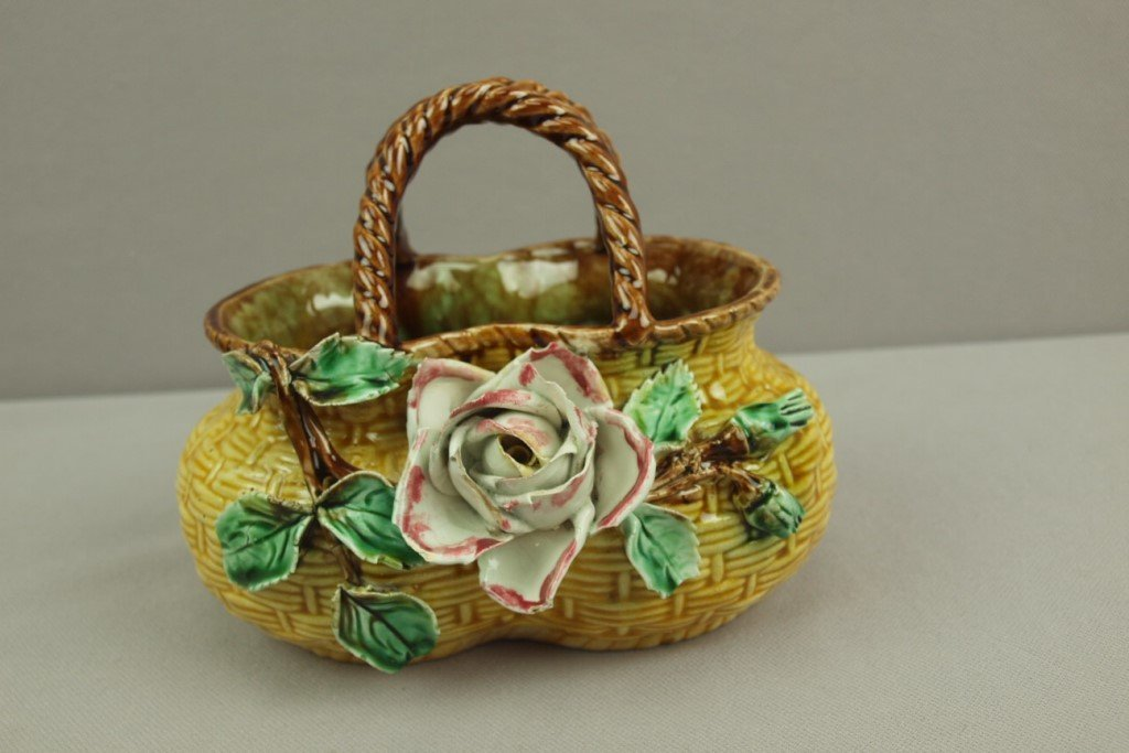 Majolica basket with applied flowers, losses to leaves