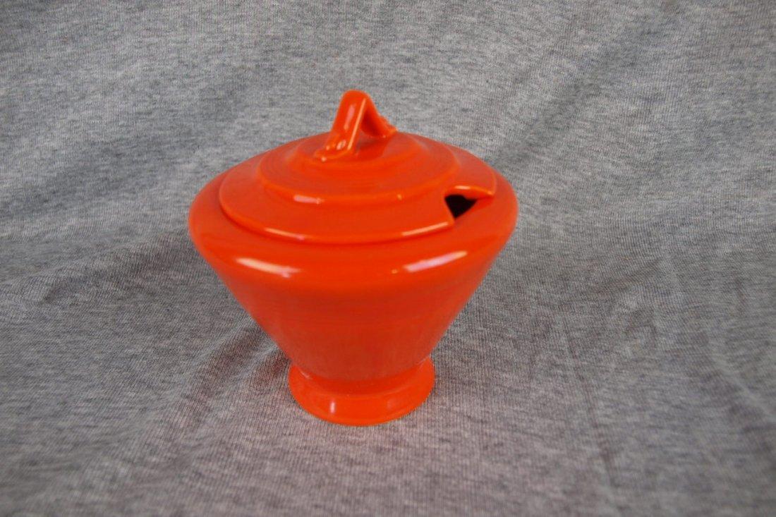 Harlequin red marmalade, minor nick to base