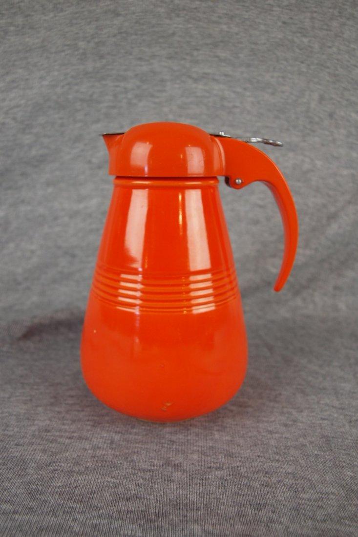 Fiesta Harlequin red syrup pitcher, glaze nick