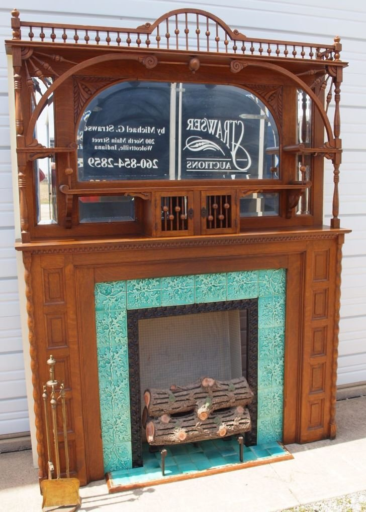 Oak stick and ball fireplace mantle with majolica