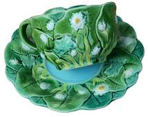 An extremely rare Minton Majolica lily cup and  saucer