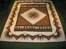 Mariners Compass Quilt in Green, Red, and