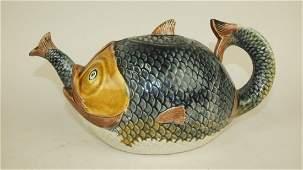 "Majolica fish swallowing fish figural teapot, 11""w"