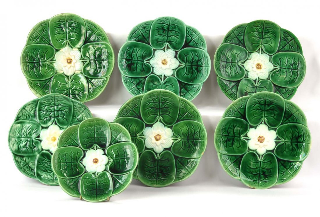 Majolica lot of 7 pond lily plates, some wear