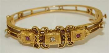 14K yellow gold hinged bangle bracelet with diamond