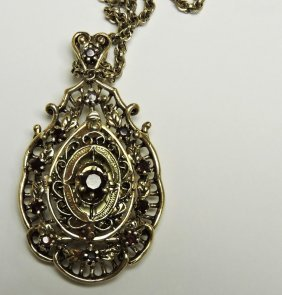 14kt Yellow Gold And Garnet Pendant Watch