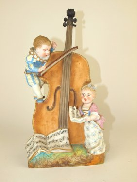 German Bisque Figural Vase Of Cello With Children 12""