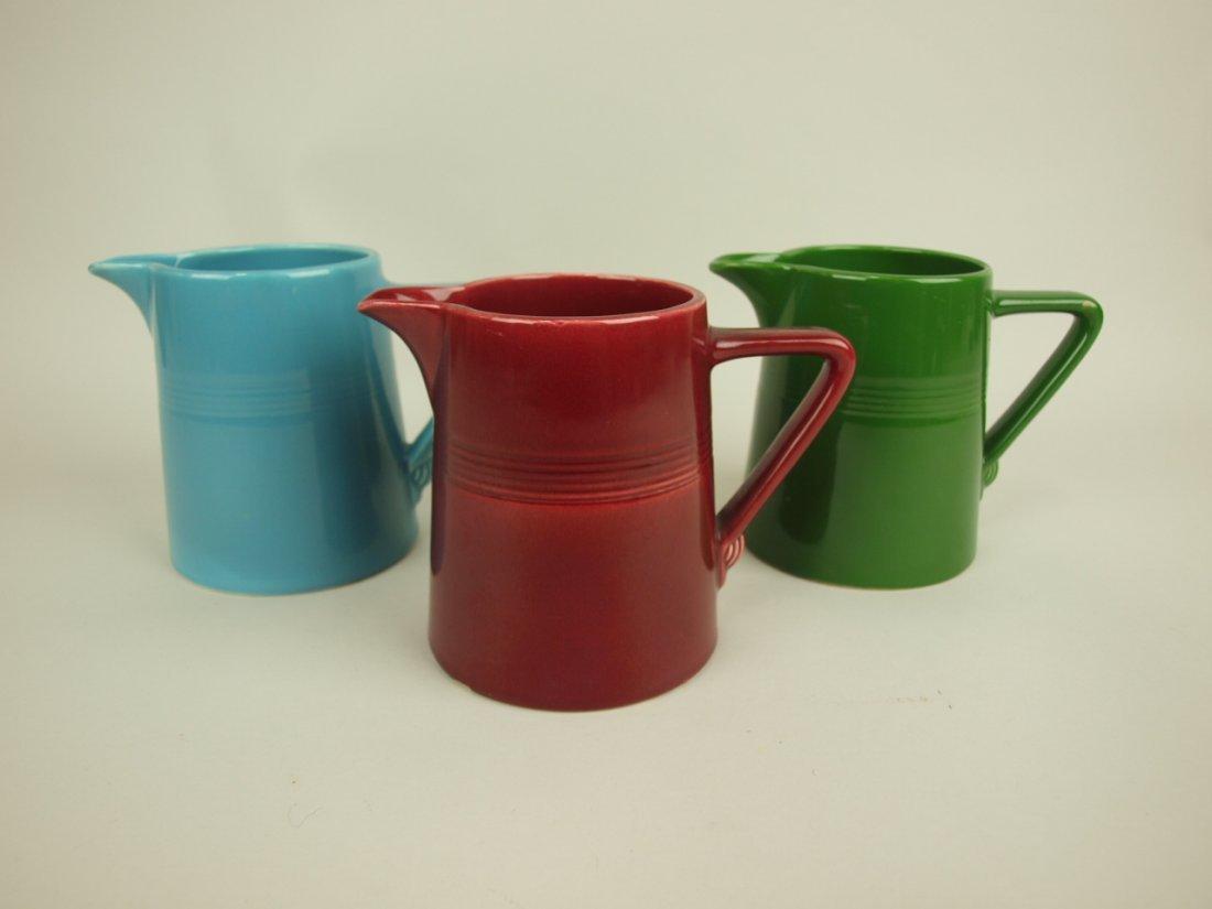 Fiesta Harlequin 22 oz jug group: maroon, turquoise,