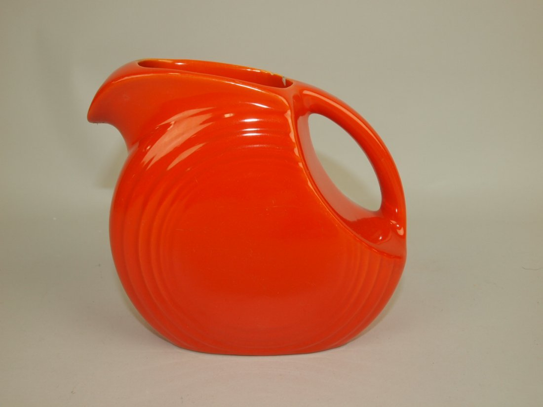 Fiesta disk juice pitcher, red, chip, hairline