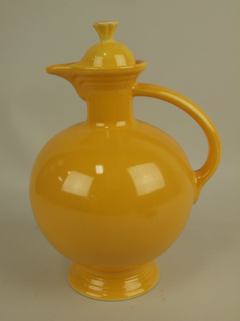 Fiesta water carafe, yellow, nick to finial