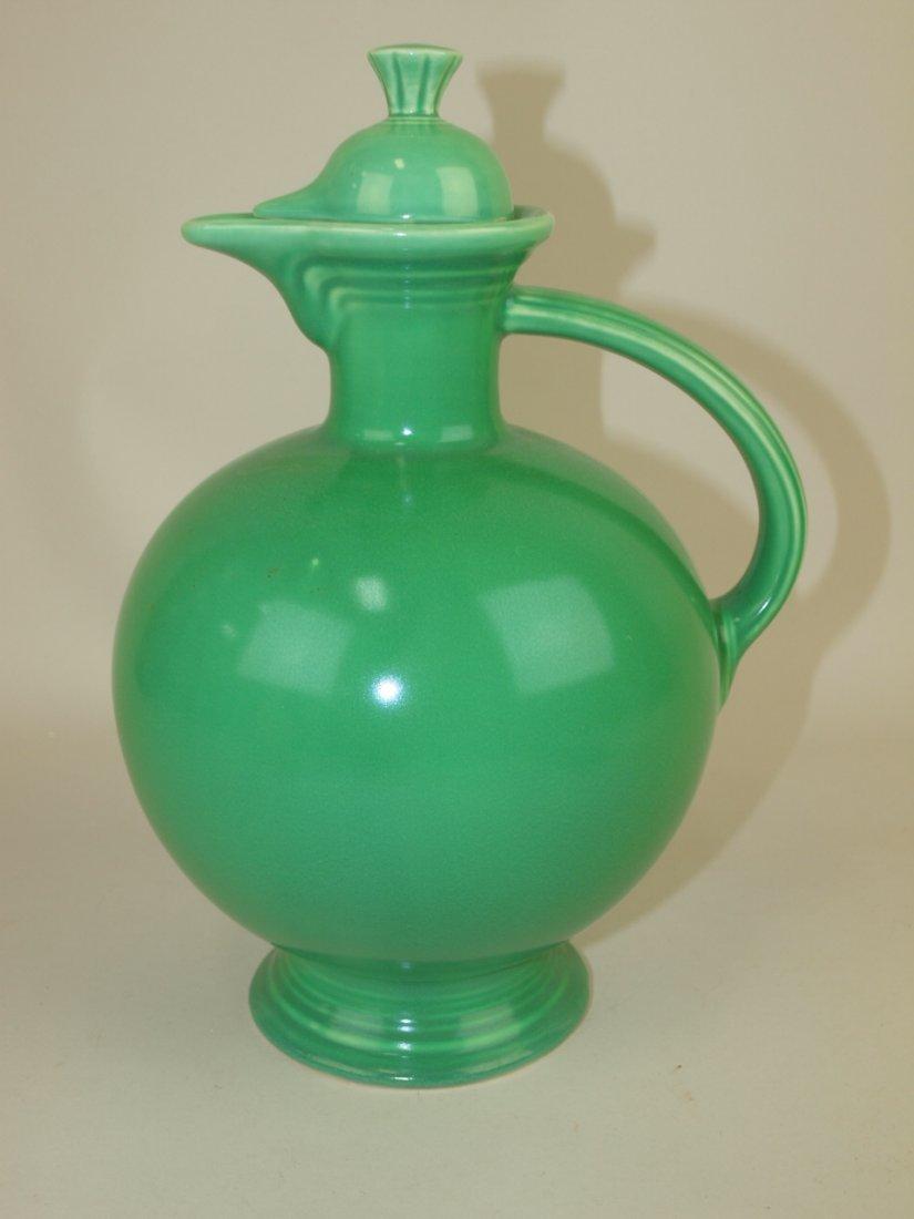 Fiesta water carafe, green, nick to top, base repair
