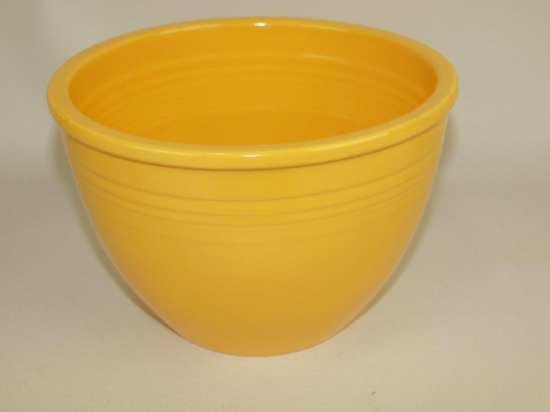 Fiesta #4 mixing bowl, yellow, nick