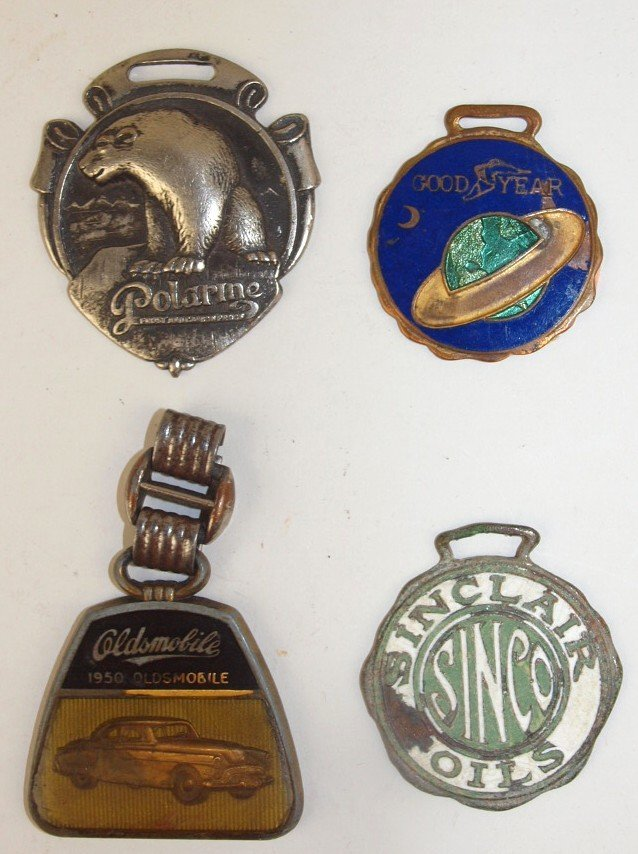 Lot of 4 watch fobs: Polarine, Goodyear, Oldsmobile, &