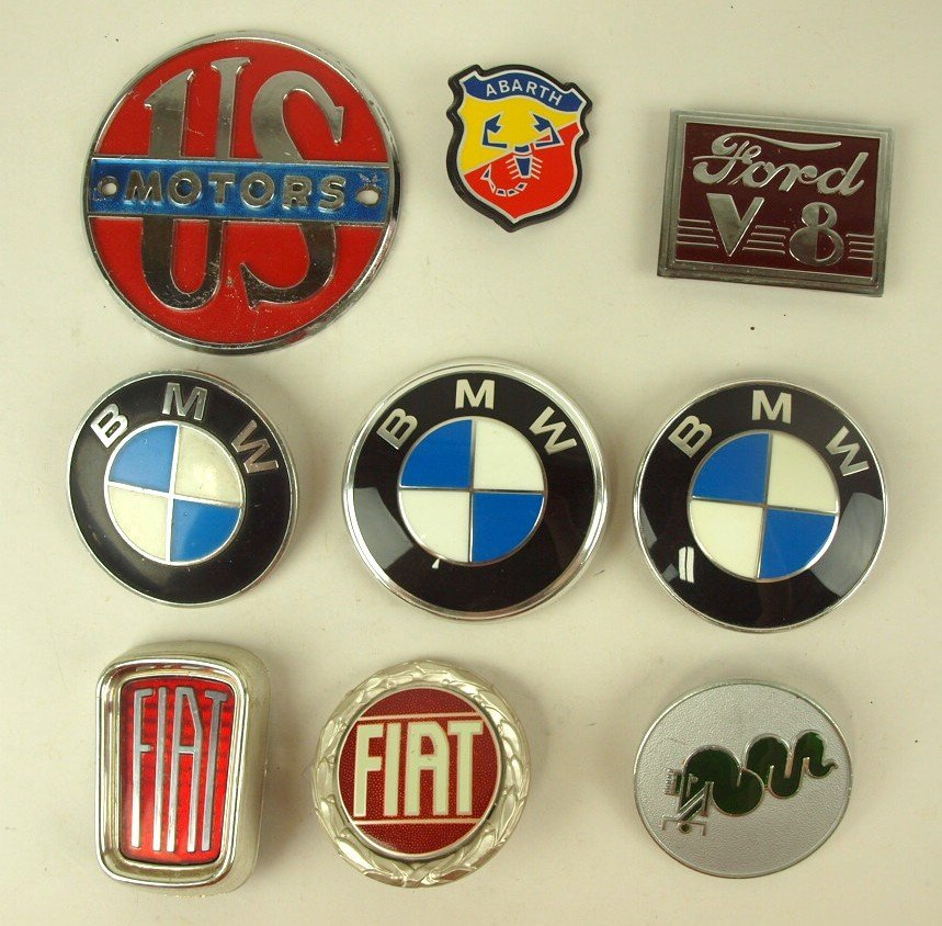 Lot of 9 auto badges & emblems: US Motors, Abarth, Ford