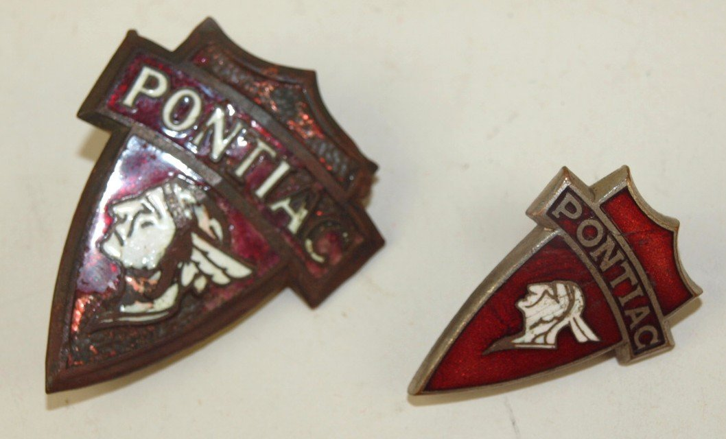 Pontiac lot of 2 enameled emblem badges