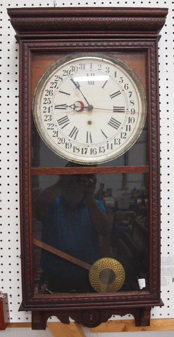 Oak Sessions wall regulator clock with calendar dial