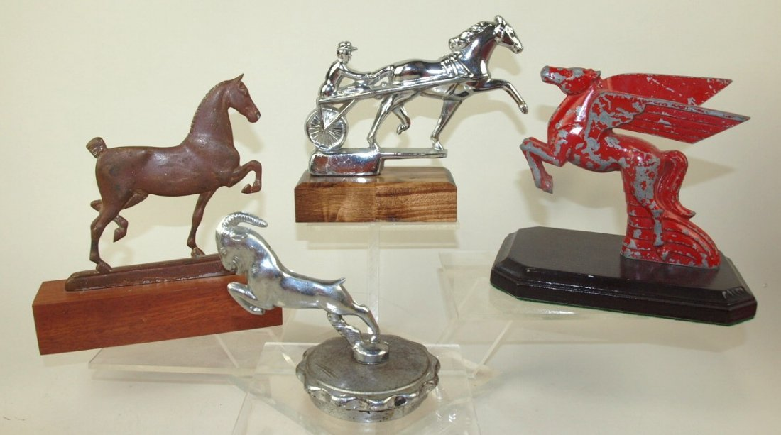 Lot of 4 hood ornaments: horse with sulky and rider,