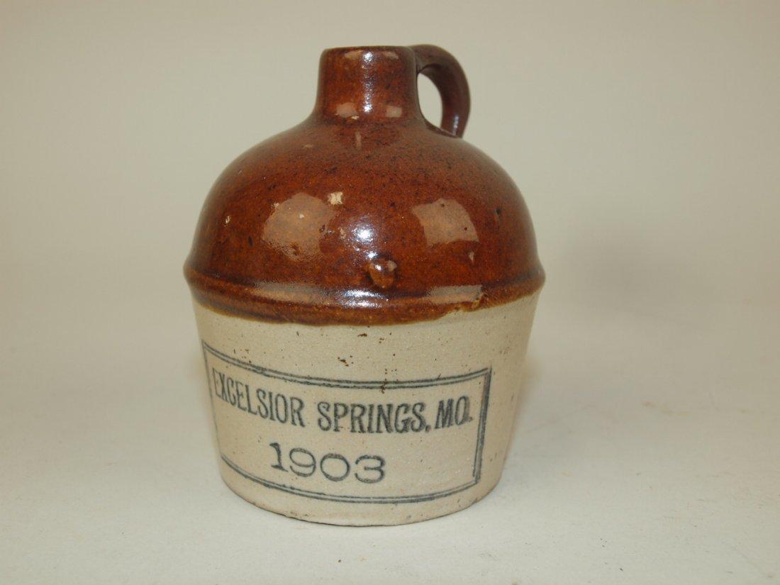 Stoneware miniature brown & white advertising jug