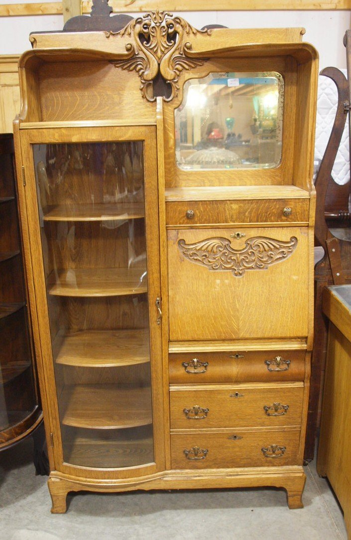 Oak curved glass secretary bookcase with griffen hands