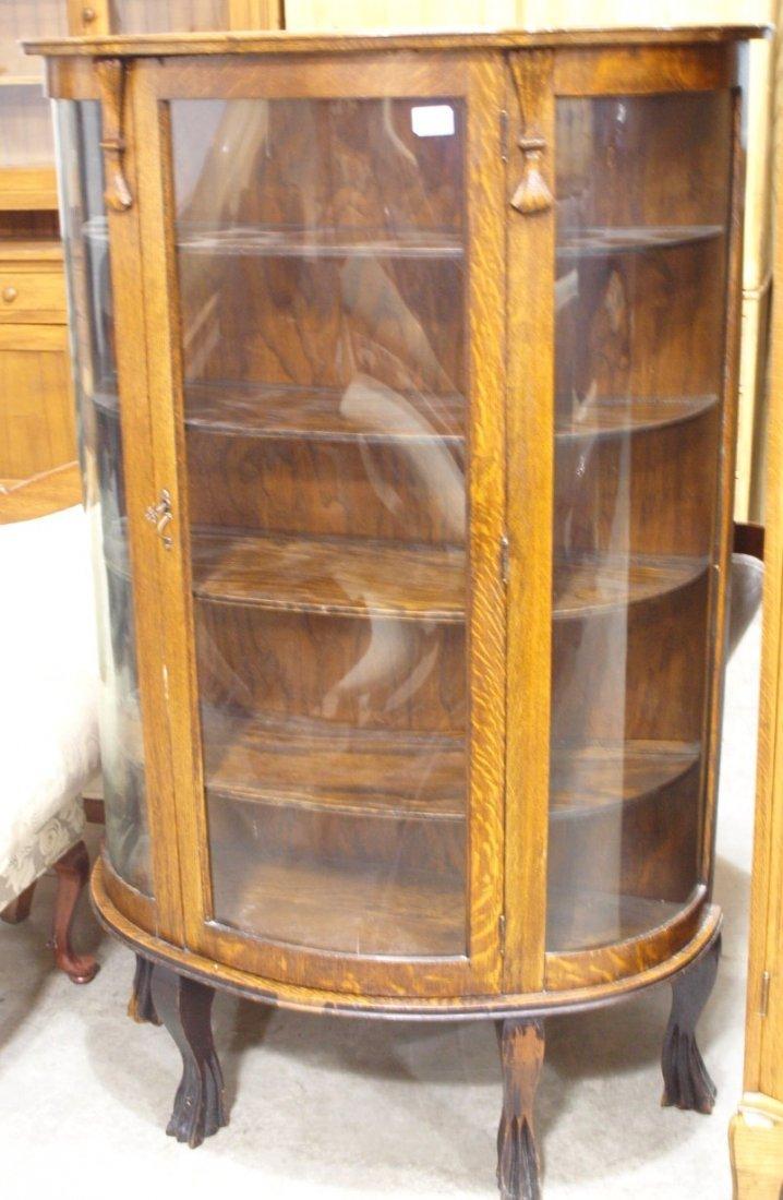 "Oak triple curved glass china cabinet, 56""h, 36""w"