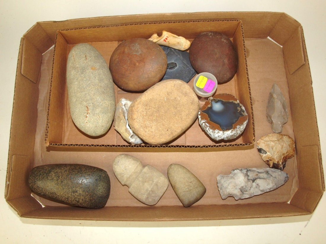 Box of Native American Indian relics: ax, celts, and