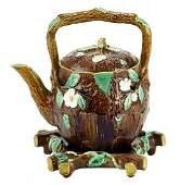 A Holdcroft Majolica Rustic Tea Kettle on Trivet