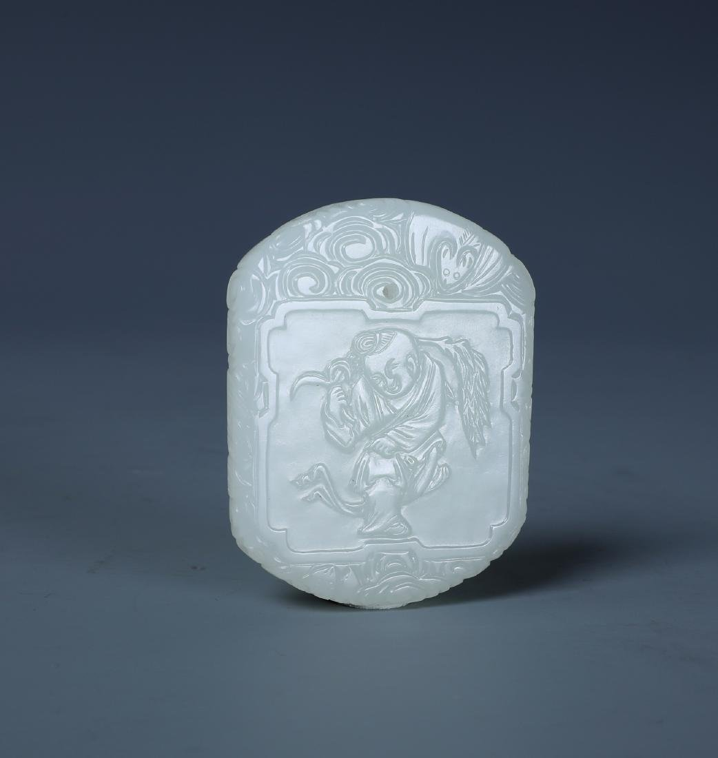 A CHINESE CARVED WHITE JADE BOY PENDANT PLAQUE