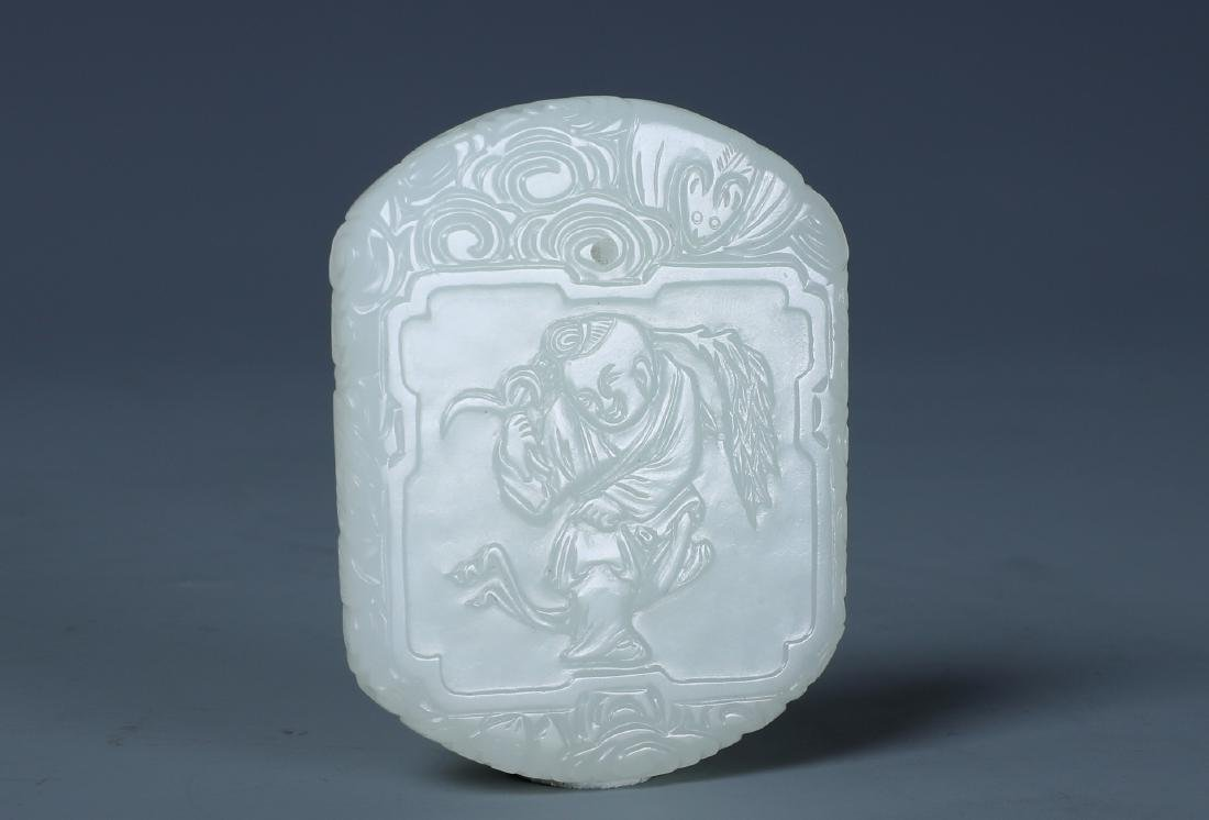 A CHINESE CARVED WHITE JADE BOY PENDANT PLAQUE - 2