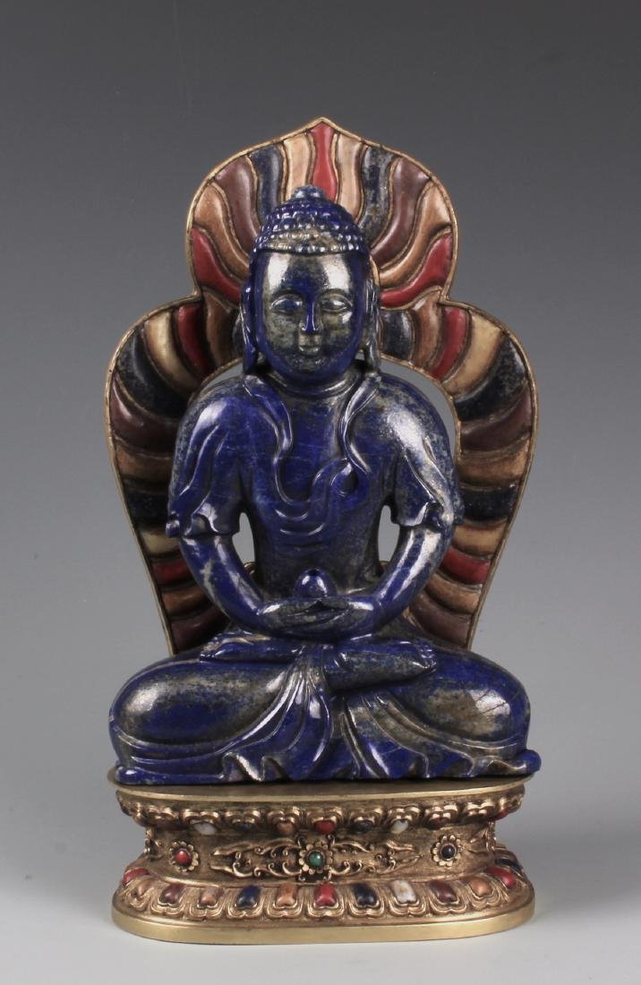 A CHINESE CARVED LAPIS FIGURE OF AMITAYUS WITH CINNABAR